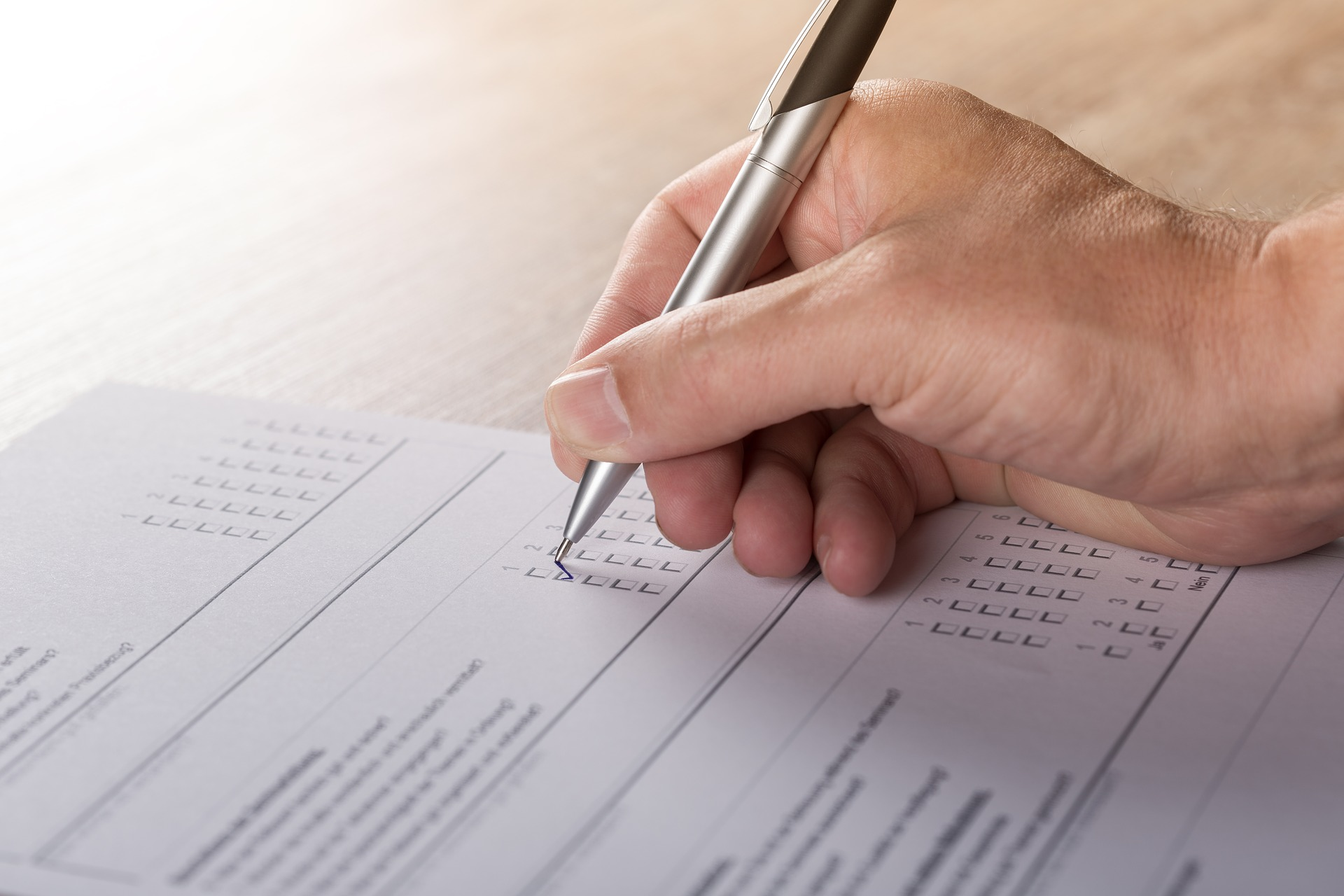 photo of hand filling out a survey