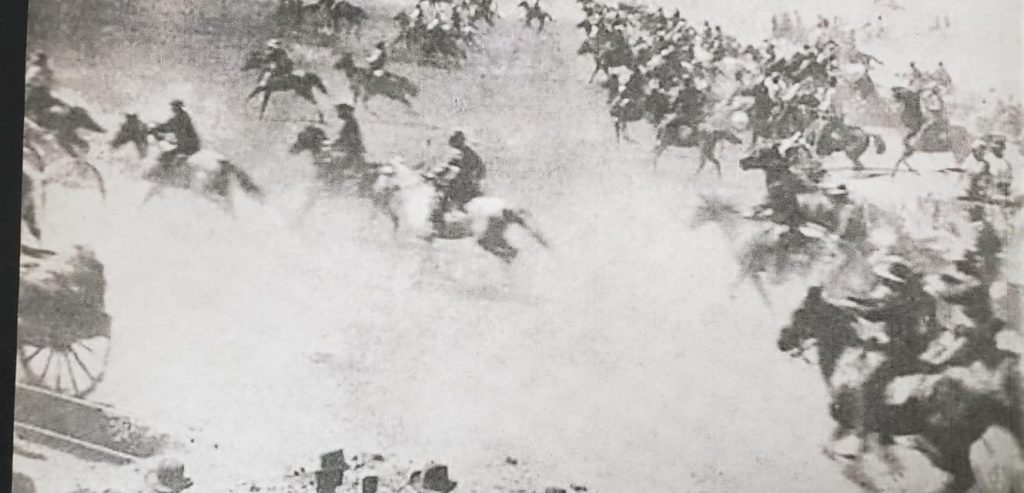 picture of the cherokee strip land run with riders on horseback