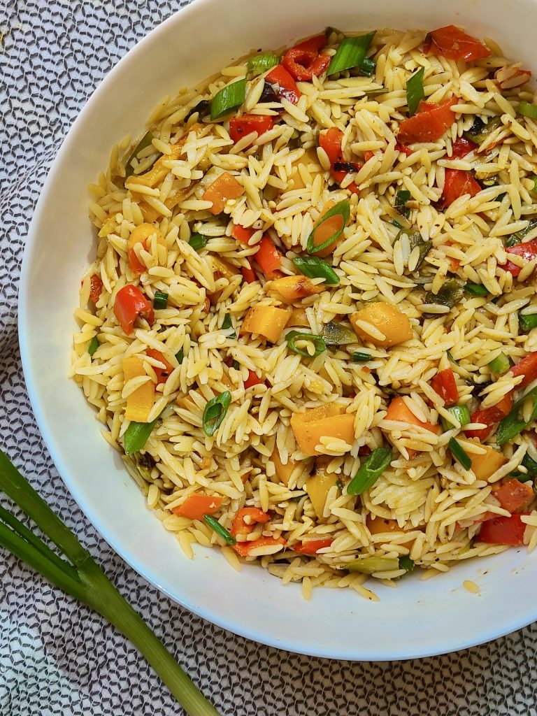 photo of orzo pasta with chicken and vegetables