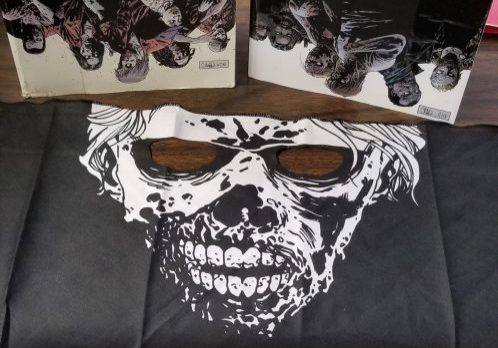 photo of walking dead compendiums 1 & 3 and skull bandana